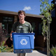 Owner Tim Szurgot carries recycling for Organic Housekeepers